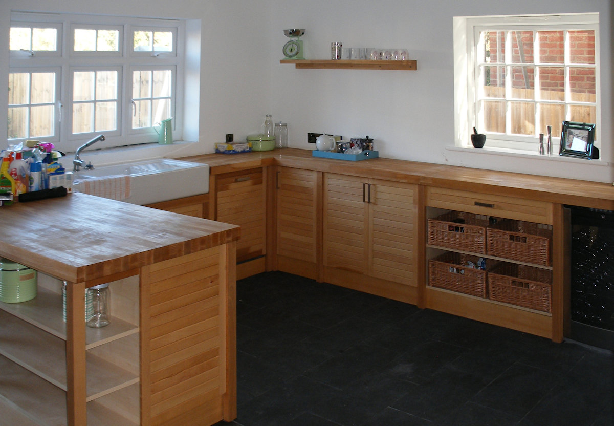 A spacious kitchen with access to the side garden becomes a social as well as functional cooking space